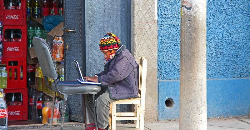 a little boy in Colombia using a laptop