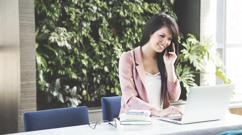 woman at phone and computer
